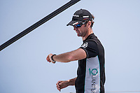 IBIZA, SPAIN - 3 JUL:  Quantum Racing crew member checks the time during day two of Royal Cup at Marina Ibiza on July 03rd 2013 in Ibiza, Spain. Photo by Xaume Olleros / 52 Super Series