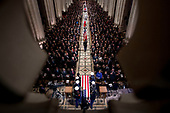The flag-draped casket of former President George H.W. Bush is arrives carried by a military honor guard during a State Funeral at the National Cathedral, Wednesday, Dec. 5, 2018,  in Washington. <br /> Credit: Andrew Harnik / Pool via CNP