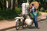 Pictured: Sacks filled with potatoes loaded on a bike in Rwanda.<br /> <br /> Goods as varied as mattresses and cabbages are precariously balanced on bikes and hauled enormous distances to be sold at market stalls.  A series of photos show workers in the Democratic Republic of Congo and neighbouring Rwanda walking up to 20 miles as they transport their wares from small villages and farms to city marketplaces.<br /> <br /> One shot even shows a man riding a motorbike with seven multi-coloured mattresses tied to the back.  Bicycles laden with sacks bursting full of potatoes will weight more than 30 stones, as workers wheel them from their homes to be sold.  SEE OUR COPY FOR DETAILS.<br /> <br /> <br /> Please byline: Joe Dordo Brnobic/Solent News<br /> <br /> © Joe Dordo Brnobic/Solent News & Photo Agency<br /> UK +44 (0) 2380 458800