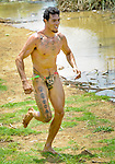 A Rapanui man runs during a competition on Easter Island on February 5, 2012.
