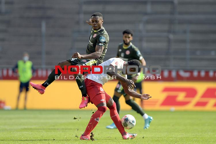 nph00351: v.li:Ridle BAKU (1.FSV Mainz 05),<br /> Aktion,Zweikampf gegen <br /> Jhon CORDOBA (1.FC Koeln).<br /> Sport: Fussball: 1. Bundesliga: Saison 19/20: 26.Spieltag: 1.FC KOELN-FSV MAINZ 05,17.05.2020.<br /> Foto: Anke Waelischmiller/SVEN SIMON/POOL / via Meuter/nordphoto<br /> <br /> Nur für journalistische Zwecke! Only for editorial use!<br /> Gemäß den Vorgaben der DFL Deutsche Fußball Liga ist es untersagt, in dem Stadion und/oder vom Spiel angefertigte Fotoaufnahmen in Form von Sequenzbildern und/oder videoähnlichen Fotostrecken zu verwerten bzw. verwerten zu lassen. DFL regulations prohibit any use of photographs as image sequences and/or quasi-video.