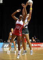 01.11.2012 England's Eboni Beckford-Chambers and South Africa's Chrisna Bootha in action during the netball test match between England and South Africa as part of the Quad Series played at the Claudelands Arena in Hamilton. Mandatory Photo Credit ©Michael Bradley.