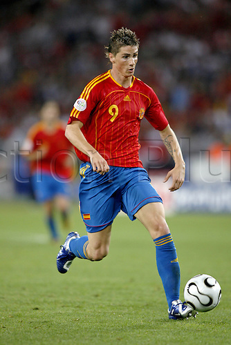19 June 2006: Spanish striker Fernando Torres runs with the ball during the Fifa World Cup Group H match between Spain and Tunisia  played at the Gottlieb-Daimler Stadium, Stuttgart. Spain won the game 3-1. Photo: Neil Tingle/actionplus...060619 football soccer player