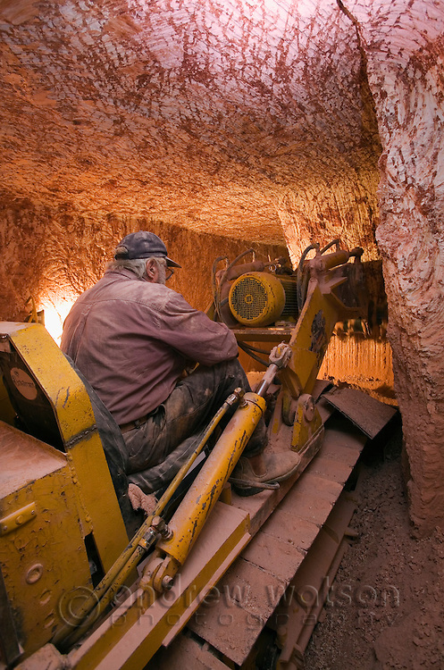 Tunneling machine in action performing a 'drive' (digging a horizontal tunnel along the opal seam).  Coober Pedy, South Australia, AUSTRALIA.