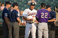 Bowie Baysox manager Brad Komminsk (49) exchanges lineup cards with Akron Aeros manager Mike Sarbaugh (22) at Prince Georges Stadium in Bowie, MD, Tuesday June 17, 2008.