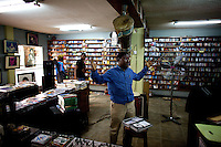 The owner of the Jazz hole, a prominent record store debates with a customer about an old nigerian performer  in Nigeria's capital Lagos on Saturday March 28 2009..