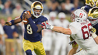 Malik Zaire (9) is pressured by Stanford Cardinal defensive tackle Harrison Phillips (66) in the third quarter.