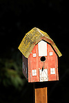 Barn birdhouse with moss.