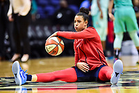Washington, DC - June 15, 2018: Washington Mystics guard Natasha Cloud (9) dribbles the ball while sitting on the groung during warm up;s before game between the Washington Mystics and New York Liberty at the Capital One Arena in Washington, DC. (Photo by Phil Peters/Media Images International)