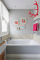 The bathroom is decorated in soft grey with white bathroom fittings.