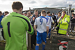 Vauxhall Motors FC 0 Solihull Moors 2, 26/04/2014. Rivacre Park, Conference North. The home team players leaving the pitch for the last time after Vauxhall Motors played Solihull Moors at Rivacre Park in the final Conference North fixture of the season. It was to be the last match for the Ellesmere Port-based home club, named after the giant car factory in the town, who have resigned from the professional pyramid system to return to local amateur football due to spiralling costs and low attendances. Their final match resulted in a 2-0 home defeat, watched by a crowd of only 215. Photo by Colin McPherson.