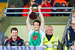 Eoin Doody, Na Gaeil captain holds aloft the Junior Cup having defeated St Senans in the Junior Premier football championship final on Sunday.