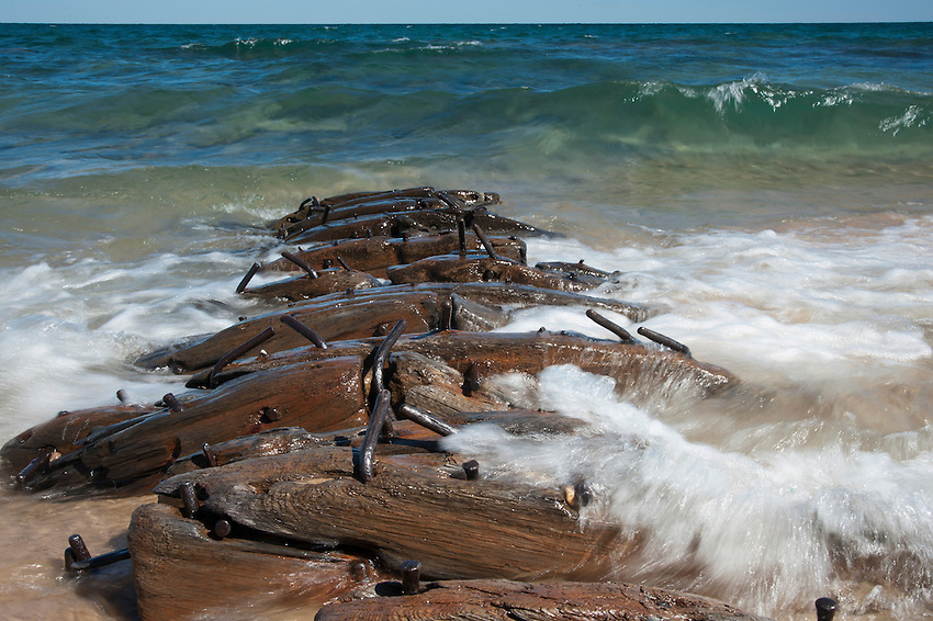 Lake Superior waves wash the remains of a 19th Centuary shipwreck near the mouth of the Hurricane River at Pictured Rocks National Lakeshore near Grand Marais, Michigan.