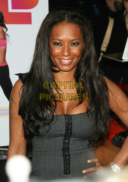 "MELANIE BROWN - MEL B .Appearance for DVD ""Totally Fit"".at Virgin Megastore Times Square, .New York, NY, USA, February 3rd 2009..half length fitness photocall grey gray cleavage .CAP/LNC/TOM.©LNC/Capital Pictures"