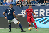 FOXBOROUGH, MA - AUGUST 31: Auro Jr #96 of Toronto FC dribbles at midfield during a game between Toronto FC and New England Revolution at Gillette Stadium on August 31, 2019 in Foxborough, Massachusetts.