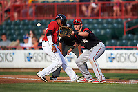 Richmond Flying Squirrels first baseman Ryder Jones (8) waits for a throw as Harold Castro (1) gets back to the bag during a game against the Erie SeaWolves on May 27, 2016 at Jerry Uht Park in Erie, Pennsylvania.  Richmond defeated Erie 7-6.  (Mike Janes/Four Seam Images)