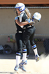 Western Nevada's Bailey Henderson, left, and Samantha Bell celebrate after Henderson's single in the bottom of the 10th inning scored Bell for the 3-2 victory over Salt Lake Community College at Edmonds Sports Complex in Carson City, Nev., on Friday, April 15, 2016. <br />Photo by Cathleen Allison/Nevada Photo Source