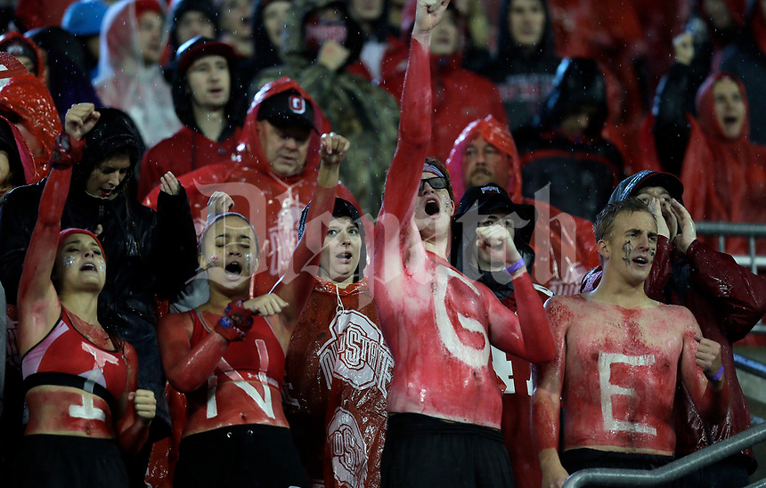 Wet OSU students cheer a Buckeyes third quarter touchdown against Illinois at Ohio Stadium November 18, 2017. [Eric Albrecht/Dispatch]