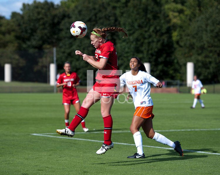 Shannon Collins (73) of Maryland heads the ball out of the box during the game at Klockner Stadium in Charlottesville, VA.  Virginia defeated Maryland, 1-0.