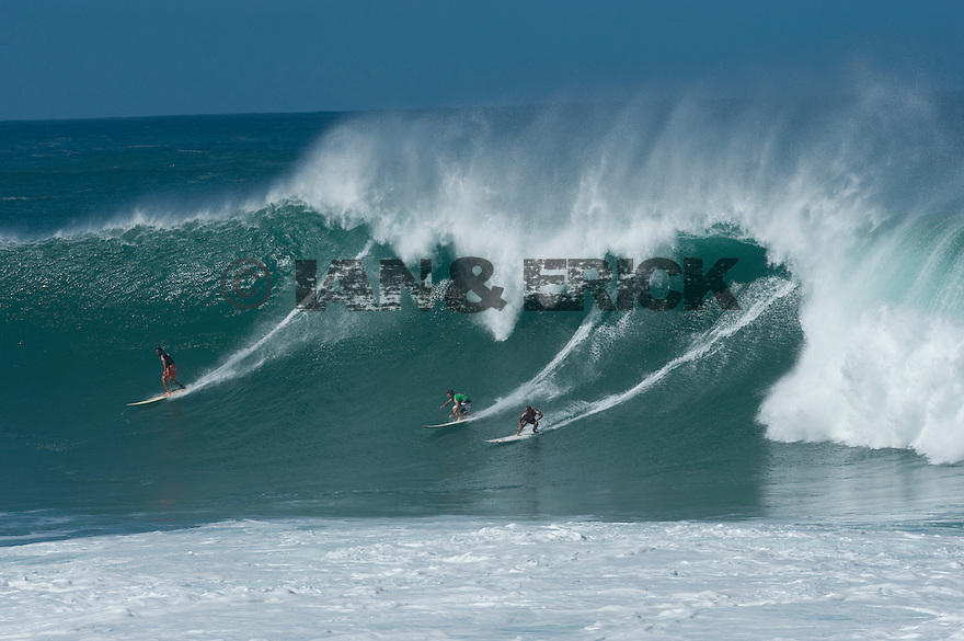 Brian Keaulana (HAW), Bruce Irons (HAW) and Ramon Navarro (CHI) during the Quiksilver Eddie Aikau at Waimea Bay on the Northshore of Oahu in Hawaii