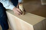 Hiromitsu Tanaka, 38, uses a special implement to bring out the grain  on kiri-tansu furniture at Kamo Kiri-tansu maker Asakura Kagu in Niigata City, Niigata Prefecture Japan on Feb. 21, 2017. ROB GILHOOLY PHOTO