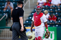 Audry Perez (10) of the Springfield Cardinals talks with Home Plate Umpire Seth Buckminster during a game against the Tulsa Drillers at Hammons Field on July 19, 2011 in Springfield, Missouri. Tulsa defeated Springfield 17-11. (David Welker / Four Seam Images)