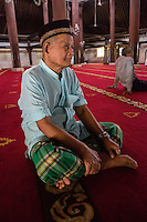 Yogyakarta, Java, Indonesia.  Man Awaiting Noon Prayers, Great Mosque, Masjid Gedhe Kauman, mid-18th. Century.