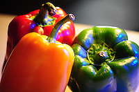 Red, yellow and green bell peppers. Photo by Eduardo Barraza © 2014