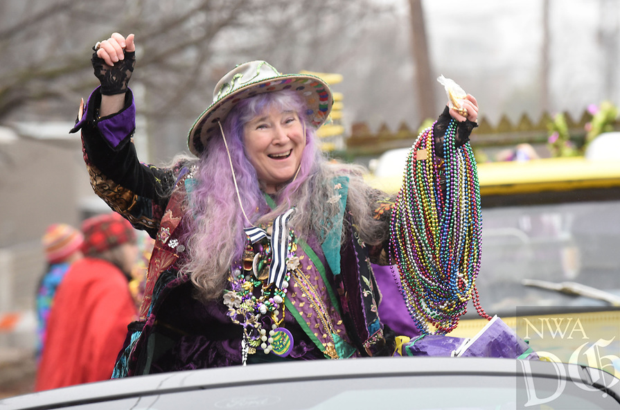 NWA Democrat-Gazette/FLIP PUTTHOFF<br /> MARDIS GRAS ON PARADE<br /> Dixie Rhyne, grand marshal of the Fat Saturday Parade of Fools Mardis Gras parade in Fayetteville, carries a good supply of party beads to toss in February while riding in the the annual parade. Rhyne helped organize the first Fayetteville Fat Saturday parade in 1992. Mardis Gras costumes, Cajun music, and lots and lots of colorful beads were part of the festivities. The parade circled the town square and rolled down Dickson Street.