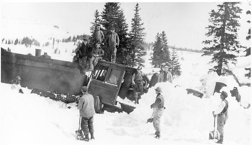 The lead D&amp;RG C-16 of a 4-engine plow train has derailed in the snow on Tanglefoot Loop and is waiting for a work crew to dig it out for rerailing.  The crew is posing atop the cab.<br /> D&amp;RG  Cumbres, CO  ca. 1918-1920