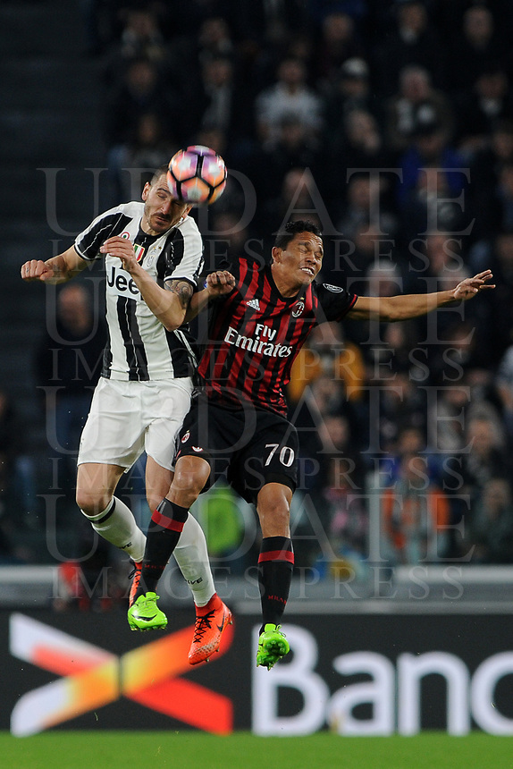 Calcio, Serie A: Juventus vs Milan. Torino, Juventus Stadium, 10 marzo 2017.<br /> Juventus' Leonardo Bonucci, left, and AC Milan's Carlos Bacca jump for the ball during the Italian Serie A football match between Juventus and AC Milan at Turin's Juventus Stadium, <br /> UPDATE IMAGES PRESS/Manuela Viganti