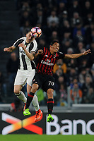 Calcio, Serie A: Juventus vs Milan. Torino, Juventus Stadium, 10 marzo 2017.<br /> Juventus&rsquo; Leonardo Bonucci, left, and AC Milan's Carlos Bacca jump for the ball during the Italian Serie A football match between Juventus and AC Milan at Turin's Juventus Stadium, <br /> UPDATE IMAGES PRESS/Manuela Viganti