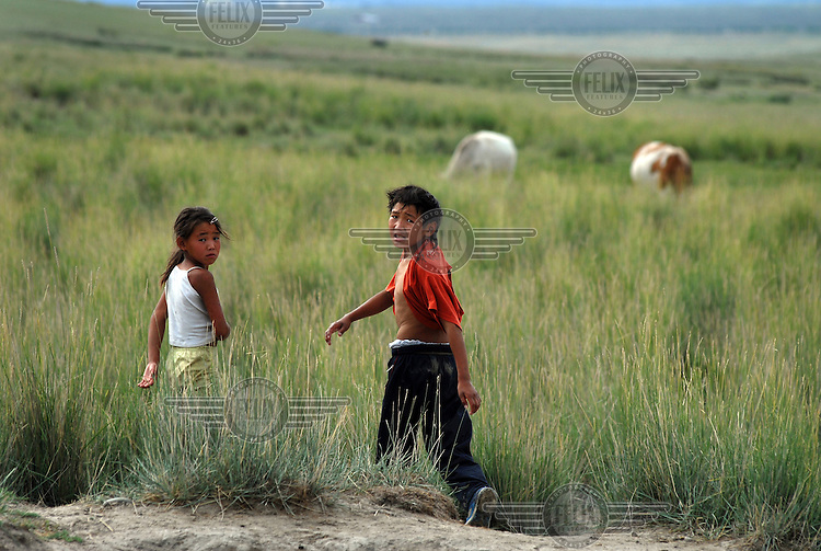 Young children charged with looking after the family horses as they graze on the outskirts of Kyzyl.