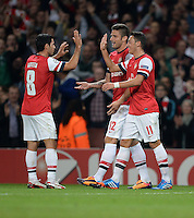 FUSSBALL   CHAMPIONS LEAGUE   VORRUNDE     SAISON 2013/2014    Arsenal London - SSC Neapel   01.10.2013 Mikel Arteta, Olivier Giroud und Mesut Oezil (v.l., alle Arsenal) jubeln