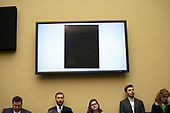 A screen displays a completely redacted document provided to Congress during the Committee on Oversight and Reform hearing on Capitol Hill in Washington D.C., U.S. to markup a resolution recommending that the House of Representatives find the Attorney General and the Secretary of Commerce in contempt of Congress on June 12, 2019.<br /> <br /> Credit: Stefani Reynolds / CNP