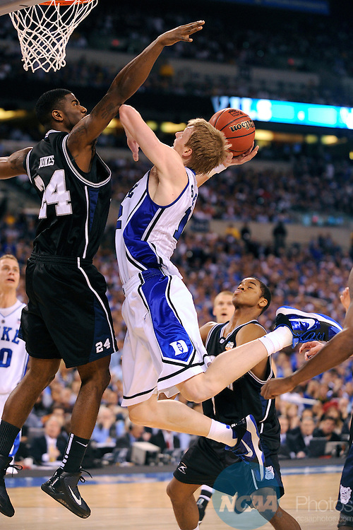 5 APR 2010: Kyle Singler (12) of Duke attempts a shot in front of Avery Jukes (24) of Butler during the championship game of the Men's Final Four Basketball Championship held at Lucas Oil Stadium in Indianapolis, IN. Duke went on to defeat Butler 61-59 to claim the championship title. Ryan McKee/NCAA Photos