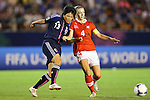 (L to R) Ayaka Michigami (JPN), Carina Gerber (SUI), .AUGUST 26, 2012 - Football / Soccer : .FIFA U-20 Women's World Cup Japan 2012, Group A .match between Japan 4-0 Switzerland .at National Stadium, Tokyo, Japan. .(Photo by Daiju Kitamura/AFLO SPORT)