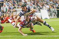 Picture by David Neilson/SWpix.com/PhotosportNZ - 10/02/2018 - Rugby League - Betfred Super League - Wigan Warriors v Hull FC  - WIN Stadium, Wollongong, Australia - Wigan's Dan Sarginson is tackled by Hull FC's Mark Minichiello.