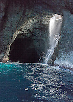 Waterfall inside a sea cave on the Na Pali Coast, Kaua'i