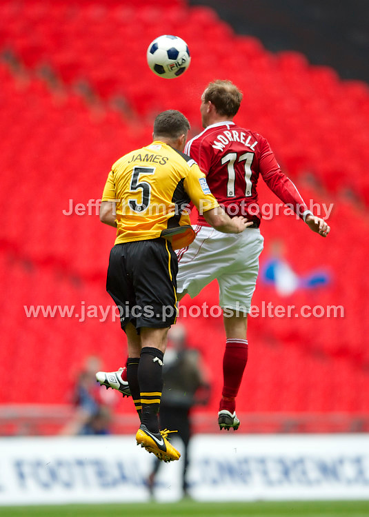 Wrexhams Andy Morrell and Newports Tony James battle for a high ball during the Newport County v Wrexham Blue Sq. Bet Premier league playoff final at Wembley Stadium, London, England Sunday 5th May 2013. Credit for pictures to Jeff Thomas Photography - www.jaypics.photoshelter.com - 07837 386244 - Use of images are restricted without prior permission of the copyright owner Jeff Thomas Photography.