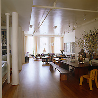 A view of the immense living/dining area of the Soho loft