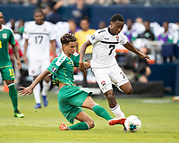 KANSAS CITY, KS - JUNE 26: Terence Vancooten #15 challenges Cordell Cato #7 during a game between Guyana and Trinidad