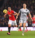 Radamel Falcao of Manchester United chases Jason Shackell of Burnley - Manchester United vs. Burnley - Barclay's Premier League - Old Trafford - Manchester - 11/02/2015 Pic Philip Oldham/Sportimage