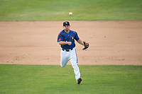 Missoula Osprey third baseman Buddy Kennedy (24) throws to first base during a Pioneer League game against the Orem Owlz at Ogren Park Allegiance Field on August 19, 2018 in Missoula, Montana. The Missoula Osprey defeated the Orem Owlz by a score of 8-0. (Zachary Lucy/Four Seam Images)