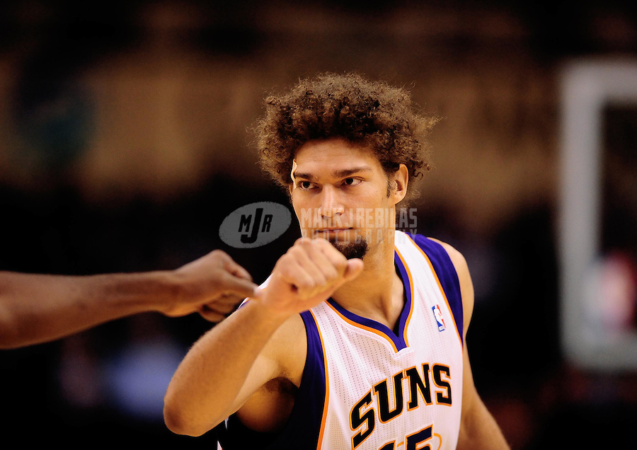 Oct. 12, 2010; Phoenix, AZ, USA; Phoenix Suns center (15) Robin Lopez against the Utah Jazz during a preseason game at the US Airways Center. Mandatory Credit: Mark J. Rebilas-