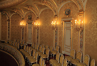 "Rows of seats, first balcony, Theatre Imperial Napoleon III de Fontainebleau (Fontainebleau Theatre Napoleon III), 1853-1856, by Hector Lefuel, lit by the original lightings of the 19th century, Fontainebleau, Seine-et-Marne, France. Restoration of the theatre began in Spring 2013 thanks to an agreement between the Emirate of Abu Dhabi and the French Governement dedicating 5 M€ to the restoration.  In recognition of the sponsorship by the Emirate of Abu Dhabi, French Governement decided to rename the theatre as ""Theatre Cheikh Khalifa bin Zayed Al Nahyan"" (Cheikh Khalifa bin Zayed Al Nahyan Theatre). The achievement of the first stage of renovation has allowed the opening of the theatre to the public on May 3, 2014. Picture by Manuel Cohen"