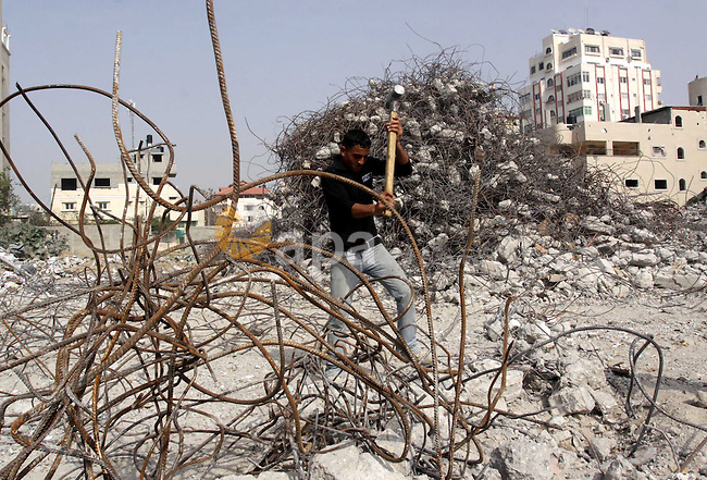 Palestinian worker extracts iron from the rubbles of the  Ministry of Justice which destroyed during the last year Israeli offensive on Gaza Strip, in Gaza City on Feb 20,2010. Photo by Mohammed Asad