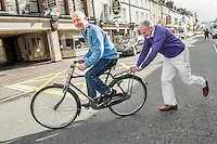 11-3-2013: REPRO FREE: On Yer Bike?. President of the Killarney Chamber of Tourism and Commerce Johnny Maguire, gets a friendly push from outgoing president Mike Buckley in Killarney on Monday after his election to the post. Mr. Maguire is famed  locally for his travel by bicycle..Picture by Don MacMonagle