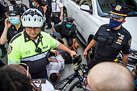 NEW YORK, NEW YORK - MAY 29: Police apprehend a Protester in anti-police protest in response to the police officer who killed George Floyd in Minneapilis in front of the Manhattan court on May 29, 2020 in New York. Across the country, protests against Floyd's death have sparked movements day and night. (Photo by Pablo Monsalve / VIEWpress via Getty Images)