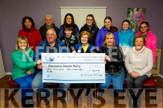 Kerry County Hunt Club present the sum of €1,545 to Recovery Haven at the centre on Monday.<br /> Seated l to r: Sheila and Raymond Sugrue, Maureen O'Brien, Rose Cotter and Marion Barnes.<br /> Back l to r: Sheila and Noel Hartnett, Sean and Laura Cotter, Amber, Ava and Caoimhe Sugrue and Juliette Bomaod.